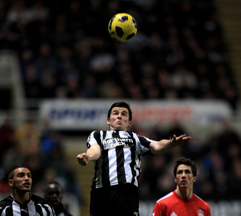 NEWCASTLE UPON TYNE, ENGLAND - DECEMBER 11:  Joey Barton of Newcastle United wins the ball during the Barclays Premier League match between Newcastle United and Liverpool at St James' Park on December 11, 2010 in Newcastle, England.  (Photo by Mark Thomps