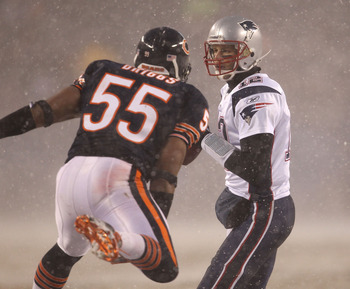 CHICAGO, IL - DECEMBER 12: Lance Briggs #55 of the Chicago Bears rushes against Tom Brady #12 of the New England Patriots at Soldier Field on December 12, 2010 in Chicago, Illinois. The Patriots defeated the Bears 36-7. (Photo by Jonathan Daniel/Getty Ima