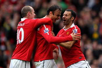 MANCHESTER, ENGLAND - SEPTEMBER 19:  Dimitar Berbatov of Manchester United celebrates scoring his team's second goal with team mates Wayne Rooney and Ryan Giggs (R) during the Barclays Premier League match between Manchester United and Liverpool at Old Tr