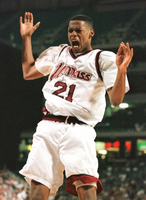 23 Mar 1996: Center Marcus Camby of the UMass Minutemen celebrates after finishing off a dunk in the second half of the Minutemen''s 86-62 NCAA East Regional Championship victory over the Georgetown Hoyas at Georgia Dome in Atlanta, Georgia.
