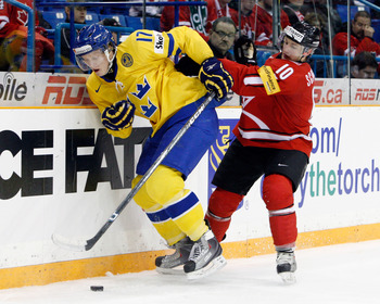 SASKATOON, SK - JANUARY 5:  Carl Klingberg #17 of Team Sweden skates with the puck while being chased by Tristan Scherwey #10 of Team Switzerland during the 2010 IIHF World Junior Championship Tournament Bronze Medal game on January 5, 2010 at the Credit