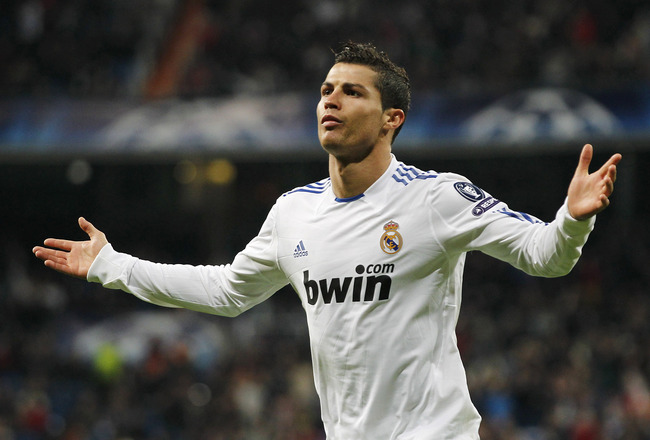 MADRID, SPAIN - DECEMBER 08:  Cristiano Ronaldo of Real Madrid celebrates after scoring Real's second goal during the Champions League group G match between Real Madrid and AJ Auxerre at Estadio Santiago Bernabeu on December 8, 2010 in Madrid, Spain.  (Ph