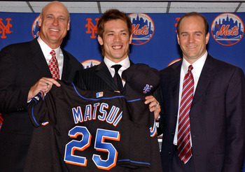 Manager Art Howe, Kaz Matsui, and Jim Duquette