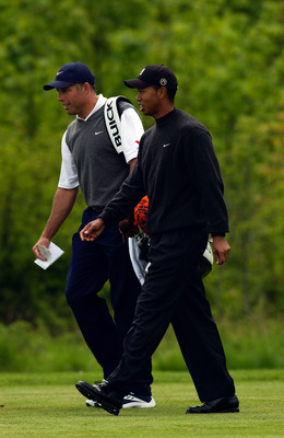 HAMBURG - MAY 14:  Tiger Woods of the USA and caddie Stevie Williams during the Pro-Am held prior to The SAP Deutsche Bank Open held on May 14, 2003 at The Gut Kaden Golf Club, in Hamburg, Germany. (Photo by Stuart Franklin/Getty Images)