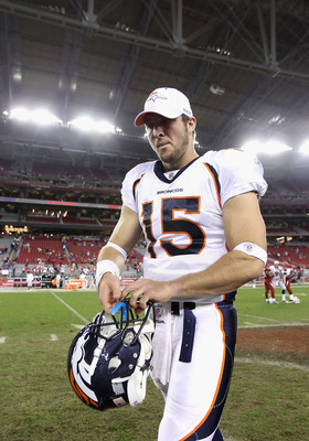 GLENDALE, AZ - DECEMBER 12:  Quarterback Tim Tebow #15 of the Denver Broncos walks off the field following the NFL game against the Arizona Cardinals at the University of Phoenix Stadium on December 12, 2010 in Glendale, Arizona.  The Cardinals defeated t