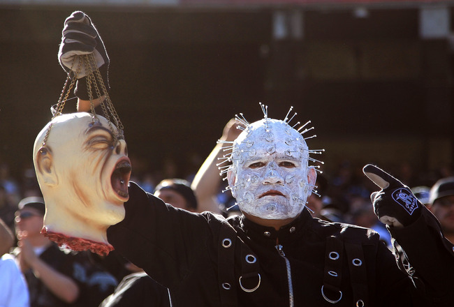 OAKLAND, CA - OCTOBER 31:  A fan holds up a fake head before the Seattle Seahawks game against the Oakland Raiders at Oakland-Alameda County Coliseum on October 31, 2010 in Oakland, California.  (Photo by Ezra Shaw/Getty Images)