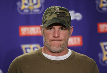 DETROIT, MI - DECEMBER 13:  Brett Favre #4 of the Minnesota Vikings talks to the media after the game against the New York Giants at Ford Field on December 13, 2010 in Detroit, Michigan. The Giants defeated the Vikings 21-3.  (Photo by Leon Halip/Getty Im