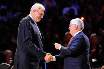 LOS ANGELES, CA - OCTOBER 27:  Head coach Phil Jackson (L) of the Los Angeles Lakers receives his championship ring from NBA Commissioner David Stern before the season opening game against the Los Angeles Clippers at Staples Center on October 27, 2009 in