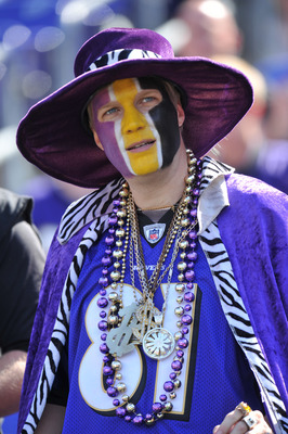 BALTIMORE, MD - OCTOBER 10: A fan of the Baltimore Ravens watches the action against the Denver Broncos at M&T Bank Stadium on October 10, 2010 in Baltimore, Maryland. Players wore pink in recognition of Breast Cancer Awareness Month. The Ravens defeated