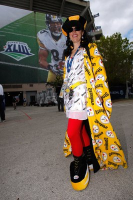 TAMPA, FL - FEBRUARY 01:  Pittsburgh Steelers fan, Trisha Simmons from Los Angeles, CA, shows support for her team as she poses in front of signage with the likeness of Hines Ward #86 on it prior to Super Bowl XLIII against the Arizona Cardinals on Februa