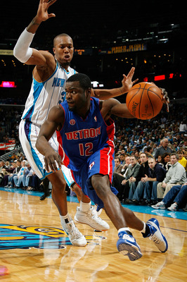 NEW ORLEANS - DECEMBER 16:  Will Bynum #12 of the Detroit Pistons drives the ball around David West #30 of the New Orleans Hornets at New Orleans Arena on December 16, 2009 in New Orleans, Louisiana.  The Hornets defeated the Pistons 95-87. NOTE TO USER: