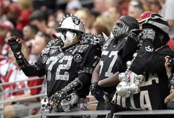 GLENDALE, AZ - SEPTEMBER 26:  Fans of the Oakland Raiders cheer during the NFL game against the Arizona Cardinals at the University of Phoenix Stadium on September 26, 2010 in Glendale, Arizona. The Cardinals defeated the Raiders 24-23.   (Photo by Christ