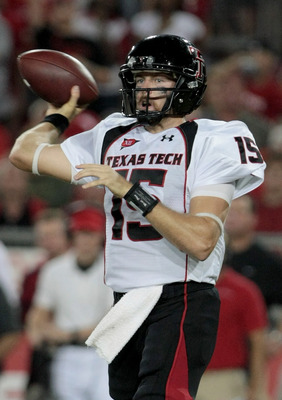 HOUSTON - SEPTEMBER 26:  Quarterback Taylor Potts #15 of the Texas Tech Red Raiders drops back in the pocket against the Houston Cougars at Robertson Stadium on September 26, 2009 in Houston, Texas.  (Photo by Thomas B. Shea/Getty Images)