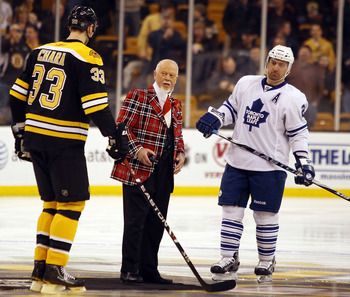 BOSTON - MARCH 04:  Don Cherry drops the puck during the ceremonial face off as Francois Beauchemin #22 of the Toronto Maple Leafs Zdeno Chara #33 of the Boston Bruins stand by on March 4, 2010 at the TD Garden in Boston, Massachusetts.  (Photo by Elsa/Ge