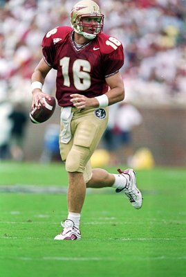 9 Oct 1999:  Chris Weinke #16 of the Florida State Seminoles moves with the ball during the game against the Miami Hurricanes at the Doak Campbell Stadium in Tallahassee, Florida. The Seminoles defeated the Hurricanes 31-21. Mandatory Credit: Andy Lyons