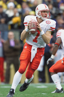BOULDER, CO - NOVEMBER 23:  Quarterback Eric Crouch #7 of the Nebraska Cornhuskers rolls to his right during the Big 12 Conference football game against the Colorado Buffaloes on November 23, 2001 at Folsom Field in Boulder, Colorado.  The Buffaloes crush