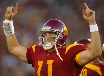 LOS ANGELES, CA - DECEMBER 03:  Quaterback Matt Leinart #11 of the USC Trojans reacts to the crowd after leaving his final home game against the UCLA Bruins on December 3, 2005 at the Los Angeles Memorial Coliseum in Los Angeles, California. USC won 66-19