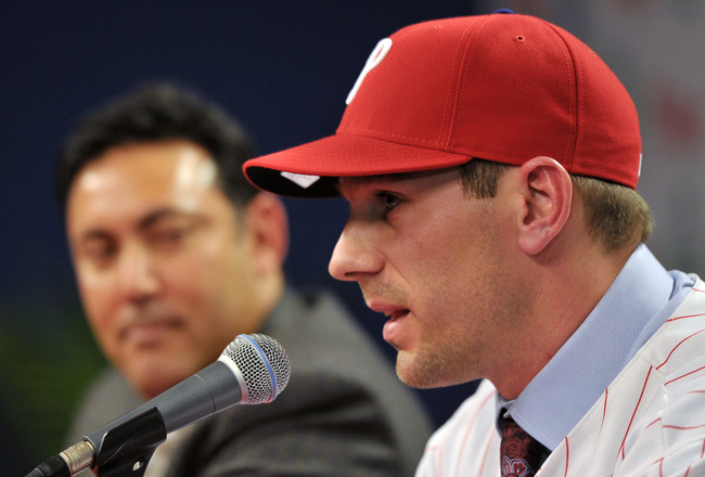 PHILADELPHIA - DECEMBER 15: Pitcher Cliff Lee #33 of the Philadelphia Phillies talks with the media while general manager Ruben Amaro Jr. watches during a press conference at Citizens Bank Park on December 15, 2010 in Philadelphia, Pennsylvania. (Photo by