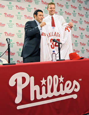 PHILADELPHIA - DECEMBER 16: Pitcher Roy Halladay of the Philadelphia Phillies and senior vice president and general manager Ruben Amaro, Jr. pose for a photograph on December 16, 2009 at Citizens Bank Park in Philadelphia, Pennsylvania. (Photo by Drew Hal