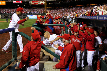 PHILADELPHIA - OCTOBER 23:  Placido Polanco #27 of the Philadelphia Phillies is congratulated by teammates after scoring on in the first inning against the San Francisco Giants in Game Six of the NLCS during the 2010 MLB Playoffs at Citizens Bank Park on