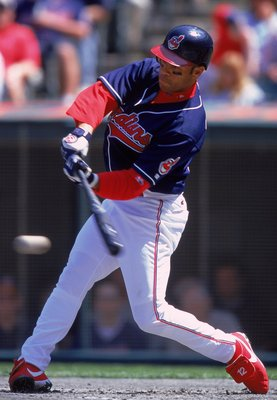15 Apr 2000:  Roberto Alomar #12 of the Cleveland Indians swings to hit the ball during the game against the Texas Rangers at the Jacobs Field in Cleveland, Ohio. The Rangers defeated the Indians 6-4. Mandatory Credit: Harry How  /Allsport