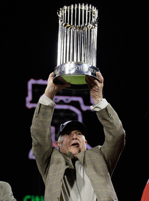 PHILADELPHIA - OCTOBER 29:  (L-R) General Manager Pat Gillick of of the Philadelphia Phillies celebrates with the World Series trophy after their 4-3 win against the Tampa Bay Rays during the continuation of game five of the 2008 MLB World Series on Octob