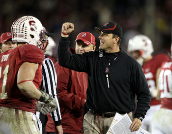PALO ALTO, CA - NOVEMBER 27:  Head coach Jim Harbaugh of the Stanford Cardinal reacts after Delano Howell #26 of the Stanford Cardinal made an interception on a pass intended for Joe Halahuni #87 of the Oregon State Beavers at Stanford Stadium on November