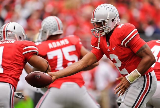 COLUMBUS, OH - OCTOBER 23:  Terrelle Pryor #2 of the Ohio State Buckeyes hands off the ball to Dan Herron #1 of the Ohio State Buckeyes  against the Purdue Boilermakers at Ohio Stadium on October 23, 2010 in Columbus, Ohio.  (Photo by Jamie Sabau/Getty Im