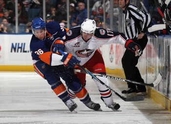 UNIONDALE, NY - NOVEMBER 24: Playing in his first NHL game, Travis Hamonic #36 of the New York Islanders holds up Andrew Murray #17 of the Columbus Blue Jackets at the Nassau Coliseum on November 24, 2010 in Uniondale, New York.  (Photo by Bruce Bennett/G