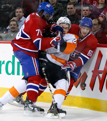 MONTREAL- NOVEMBER 16:  P.K. Subban #76 of the Montreal Canadiens body checks James van Riemsdyk #21 of the Philadelphia Flyers during the NHL game at the Bell Centre on November 16, 2010 in Montreal, Quebec, Canada.  (Photo by Richard Wolowicz/Getty Imag
