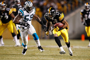 PITTSBURGH - DECEMBER 23:  Mike Wallace #17 of the Pittsburgh Steelers runs by Nic Harris #59 of the Carolina Panthers before scoring a touchdown during the game on December 23, 2010 at Heinz Field in Pittsburgh, Pennsylvania.  (Photo by Jared Wickerham/G