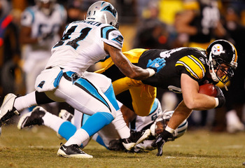 PITTSBURGH - DECEMBER 23:  Heath Miller #83 of the Pittsburgh Steelers dives after making a catch in front of Captain Munnerlyn #41 of the Carolina Panthers during the game on December 23, 2010 at Heinz Field in Pittsburgh, Pennsylvania.  (Photo by Jared