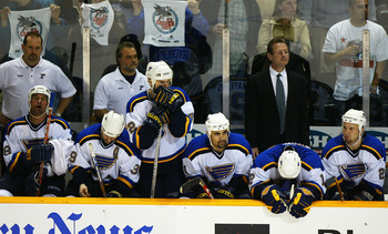 SAN JOSE, CA-  APRIL 15:  Members of the St. Louis Blues watch the game in the final seconds before loosing to the San Jose Sharks during game 5 of the West Quarterfinals of the NHL Stanley Cup Playoffs on April 15, 2004 at the HP Pavilion in San Jose, Ca