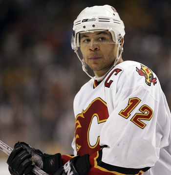BOSTON - OCTOBER 19:  Jarome Iginla #12 of the Calgary Flames skates off the ice after losing to the Boston Bruins on October 19, 2006 at TD Banknorth Garden in Boston, Massachusetts. The Boston Bruins defeated the Calgary Flames 3-2 to win their home ope