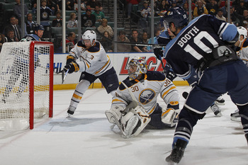 SUNRISE, FL - DECEMBER 17: David Booth #10 of the Florida Panthers scores a goal as Jordan Leopold #3 and goaltender Ryan Miller #30 of the Buffalo Sabres fail to defend the net on December 17, 2010 at the BankAtlantic Center in Sunrise, Florida. (Photo b