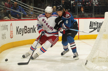 DENVER - NOVEMBER 19:  John-Michael Liles #4 of the Colorado Avalanche and Marian Gaborik #10 of the New York Rangers vie for the puck at the Pepsi Center on November 19, 2010 in Denver, Colorado. The Avalanche defeated the Rangers 5-1.  (Photo by Doug Pe
