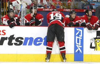 OTTAWA - MAY 13:  Jason Spezza #19 of the Ottawa Senators leans over the bench as his teammates sit dejected after losing game five of the Eastern Conference Semifinals against the Buffalo Sabres during the 2006 NHL Playoffs on May 13, 2006 at Scotiabank