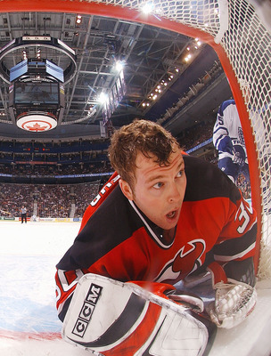 TORONTO - JANUARY 10:  Martin Brodeur #30 of the New Jersey Devils keeps his eye on the play after losing his helmet during a game against the Toronto Maple Leafs at Air Canada Centre on January 10, 2004 in Toronto, Ontario. (Photo By Dave Sandford/Getty