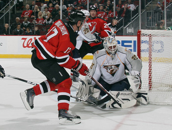 NEWARK, NJ - DECEMBER 17:  Ilya Kovalchuk #17 of the New Jersey Devils hits the post with his shot at Anders Lindback #39 of the Nashville Predators at the Prudential Center on December 17, 2010 in Newark, New Jersey. (Photo by Bruce Bennett/Getty Images)