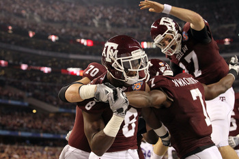 ARLINGTON, TX - JANUARY 07:  Wide receiver Jeff Fuller #8 and Uzoma Nwachukwu #7 of the Texas A&M Aggies celebrate a touchdown against the LSU Tigers during the AT&T Cotton Bowl at Cowboys Stadium on January 7, 2011 in Arlington, Texas.  (Photo by Ronald