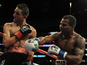 LOS ANGELES, CA - SEPTEMBER 18:  Sergio Mora takes a punch from Shane Mosley during the 10th round of the Middleweight bout at Staples Center on September 18, 2010 in Los Angeles, California.  The fight ended in a draw.  (Photo by Harry How/Getty Images)
