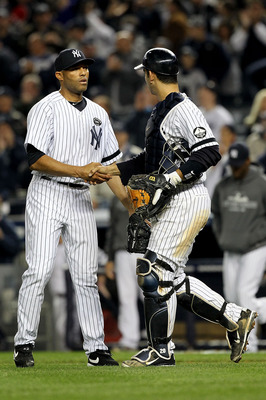 NEW YORK - OCTOBER 20:  Mariano Rivera #42 and Jorge Posada #20 of the New York Yankees celebrate after the Yankees won 7-2 against the Texas Rangers in Game Five of the ALCS during the 2010 MLB Playoffs at Yankee Stadium on October 20, 2010 in the Bronx
