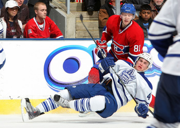 TORONTO - DECEMBER 11:  Tyler Bozak #42 of the Toronto Maple Leafs is upended by Lars Eller #81 of the Montreal Canadiens during their NHL game at Air Canada Centre on December 11, 2010 in Toronto, Ontario, Canada.(Photo By Dave Sandford/Getty Images)