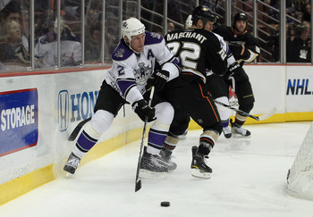 ANAHEIM, CA - NOVEMBER 29:  Matt Greene #2 of the Los Angeles Kings skates around Todd Marchant #22 of the Anaheim Ducks at the Honda Center on November 29, 2010 in Anaheim, California.  (Photo by Jeff Gross/Getty Images)