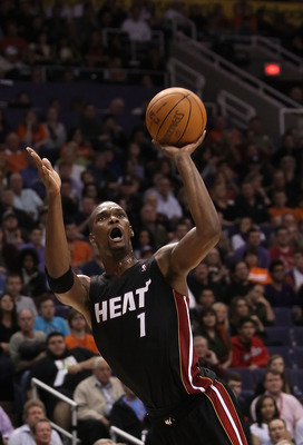 PHOENIX - DECEMBER 23:  Chris Bosh #1 of the Miami Heat puts up a shot during the NBA game against the Phoenix Suns at US Airways Center on December 23, 2010 in Phoenix, Arizona. The Heat defeated the Suns 95-83.  NOTE TO USER: User expressly acknowledges