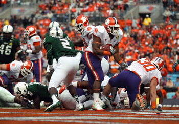 CHARLOTTE, NC - DECEMBER 31:  Jamie Harper #8 of the Clemson Tigers scores a touchdown against the USF Bulls during their game at Bank of America Stadium on December 31, 2010 in Charlotte, North Carolina.  (Photo by Streeter Lecka/Getty Images)