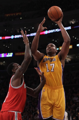 LOS ANGELES, CA - DECEMBER 21:  Andrew Bynum #17 of the Los Angeles Lakers shoots over Larry Sanders #8 of the Milwaukee Bucks during the first half at Staples Center on December 21, 2010 in Los Angeles, California. NOTE TO USER: User expressly acknowledg