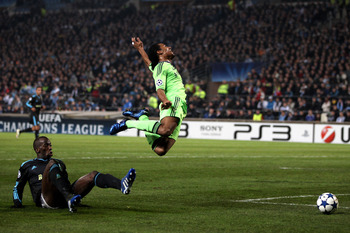 MARSEILLE, FRANCE - DECEMBER 08:  Florent Malouda of Chelsea is brought down in the area by Souleymane Diawara of Marseille, but Referee Vladislav Bezborodov of Russia refuses to award the penalty during the UEFA Champions League Group F match between Mar