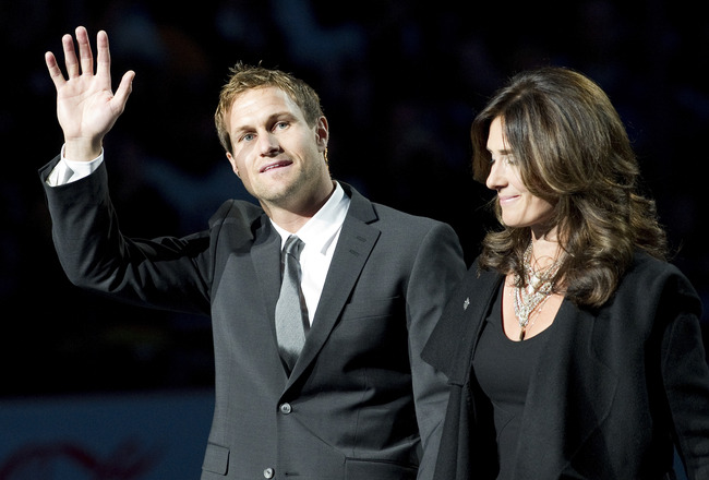 VANCOUVER, CANADA - DECEMBER 11: Markus Naslund and his wife Lotta wave to the crowd during a ceremony to retire his jersey prior to NHL action on December 11, 2010 against the Tampa Bay Lightning and the Vancouver Canucks at Rogers Arena in Vancouver, BC