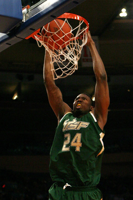 NEW YORK - MARCH 10:  Augustus Gilchrist #24 of the USF Bulls dunks the ball against the Georgetown Hoyas during the second round of 2010 NCAA Big East Tournament at Madison Square Garden on March 10, 2010 in New York City.  (Photo by Chris Trotman/Getty